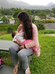 Woman breastfeeding infant