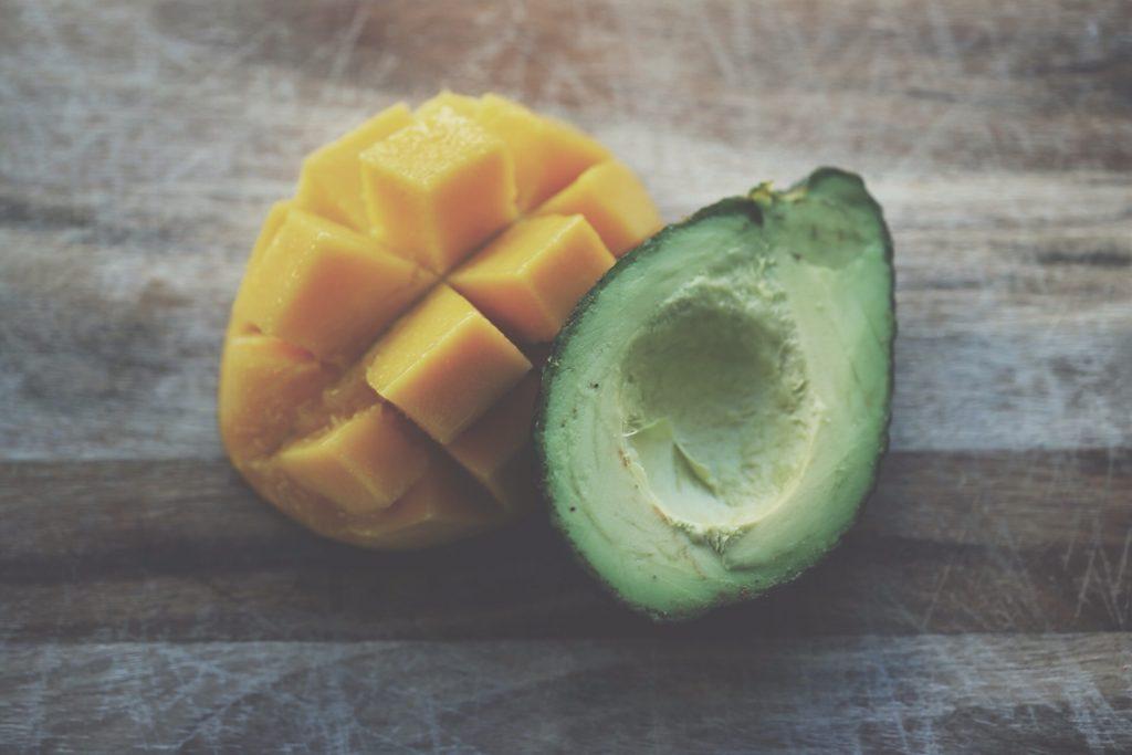 A mango and avocado cut open