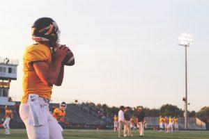 Teenager playing American Football