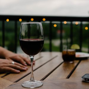 a glass of red wine on a table