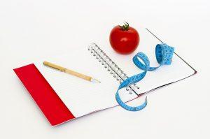 Measuring Tape, apple, notebook